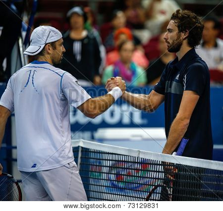 SEPTEMBER 26, 2014 - KUALA LUMPUR, MALAYSIA: Benjamin Becker (white) shakes Ernests Gulbis' hands after their match at the Malaysian Open Tennis 2014. This event is an ATP sanctioned tournament.