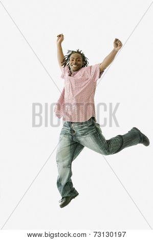 Studio shot of African man jumping