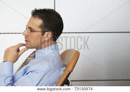 Businessman sitting in chair