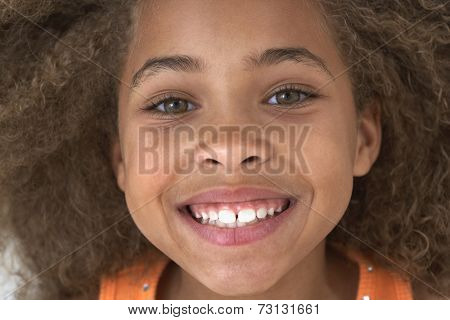 Close up of young African American girl smiling