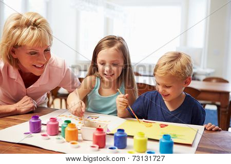 Grandmother Painting Picture With Grandchildren At Home