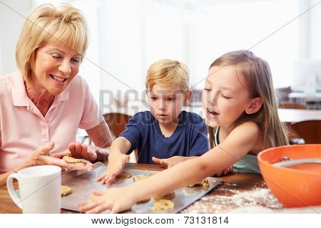Grandmother And Grandchildren Baking Cookies Together