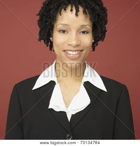 Studio shot of African businesswoman smiling