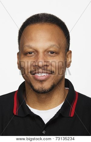 Close up studio shot of African man smiling