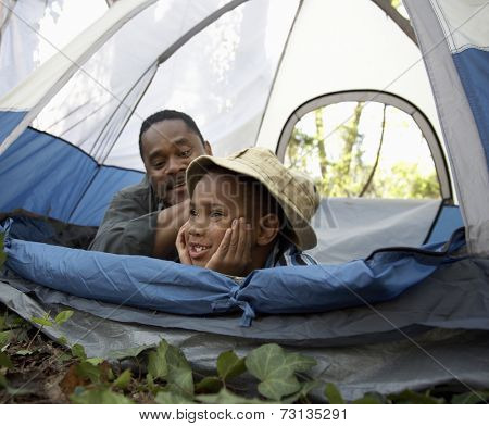 African father and son inside tent