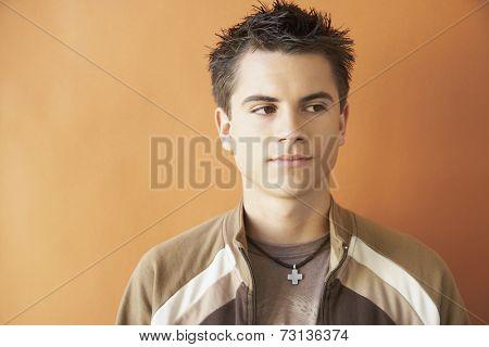 Studio shot of teenaged boy looking to side