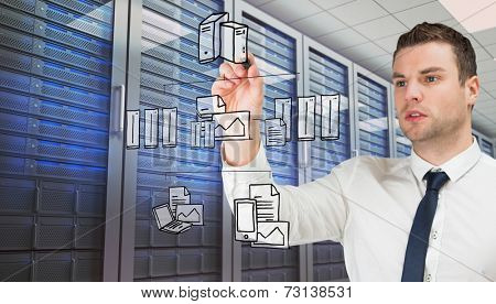 Composite image of young serious businessman writing against server room