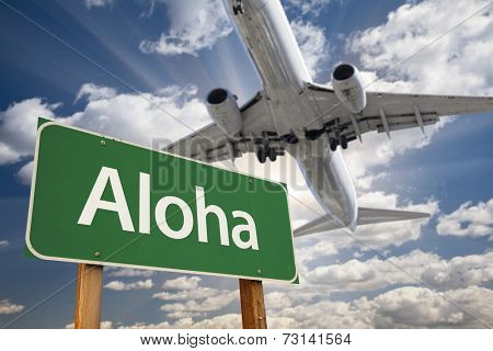 Aloha Green Road Sign and Airplane Above with Dramatic Blue Sky and Clouds.