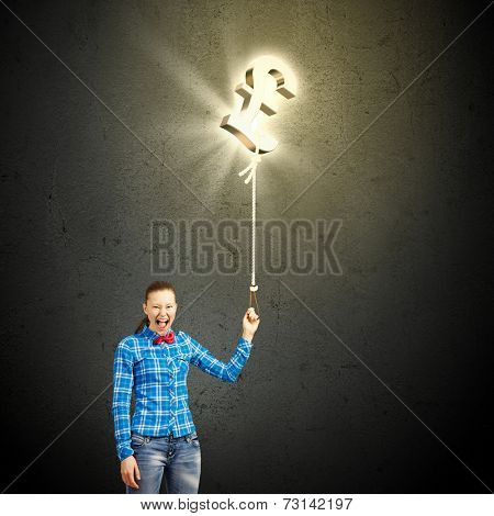Young girl in casual holding pound symbol on rope