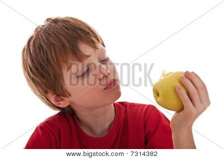 Boy Eating A Green Apple