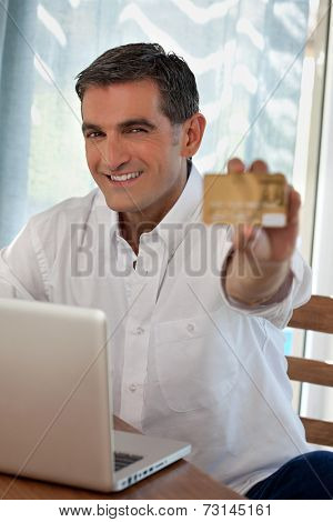 Portrait of middle ages man purchasing goods online