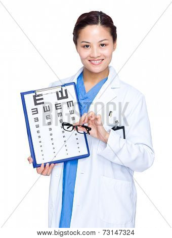 Optician hold with eye chart and glasses
