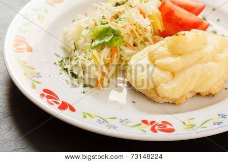 chicken schnitzer with salad
