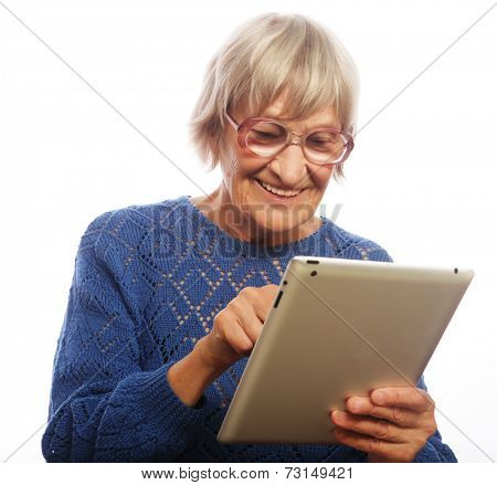 Senior happy woman using ipad isolated on white background