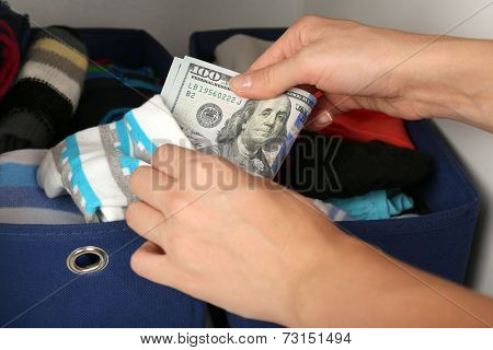 Woman hiding money in sock close up