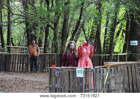 MUSKOGEE, OK - Sept. 13: A bloody zombie shows off her last