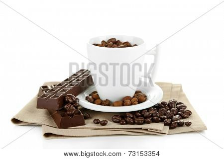 Cup with coffee beans and dark chocolate glaze, isolated on white