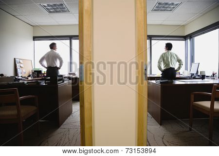 Two businessmen in neighboring offices