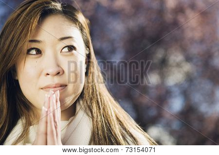 Portrait of Asian woman praying