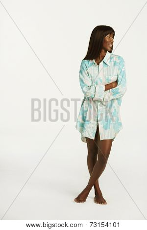 Studio shot of African woman wearing button down shirt
