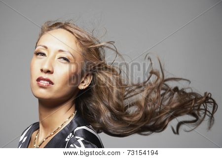 Native American woman with hair blowing