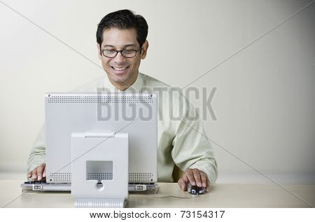 Hispanic man working on computer