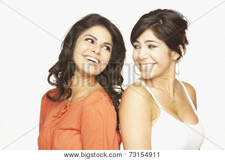 Portrait of Hispanic adult sisters