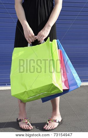 Close up of woman holding shopping bags