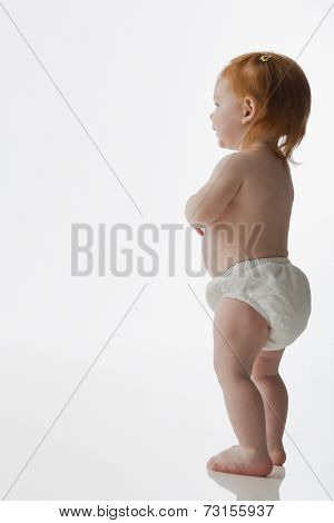 Studio shot of baby standing