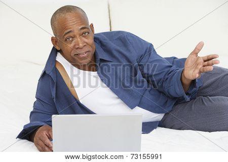 Senior African man with laptop