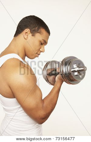 Portrait of African man lifting weights
