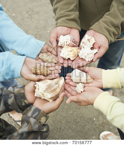 Hispanic family holding seashells