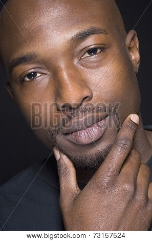 Close up of African man with hand on chin