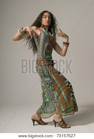 Studio shot of Asian woman dancing