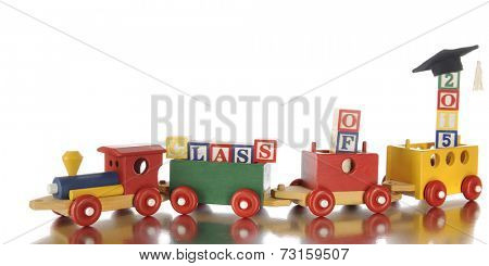 A colorful toy train carrying alphabet blocks that spell out the words