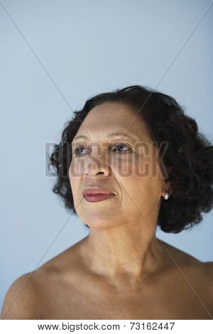 Senior African woman with bare shoulders