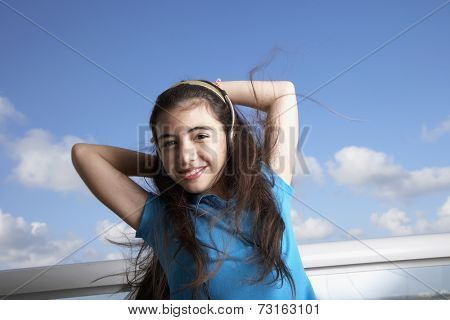 Hispanic girl listening to headphones