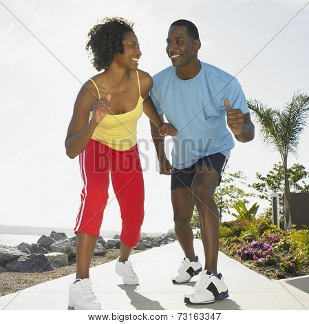 African couple wearing athletic gear