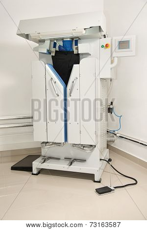 Automatic ironing machine at dry cleaner