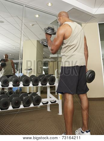 Mixed Race man lifting weights