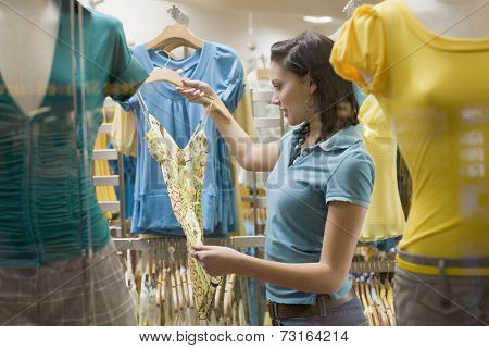 Hispanic teenage girl in clothing store
