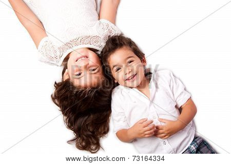 Family Siblings Laying Together
