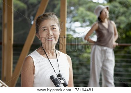 Senior Asian woman with binoculars
