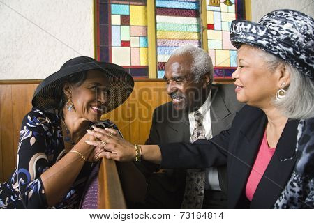African American senior talking in church