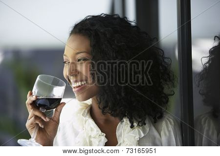 South American woman drinking wine