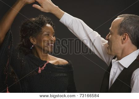 Multi-ethnic couple dancing