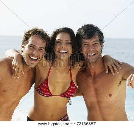 South American friends hugging at beach
