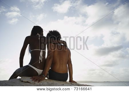 South American couple hugging at beach