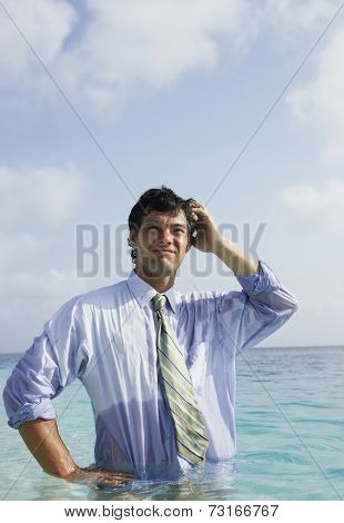 South American businessman in water