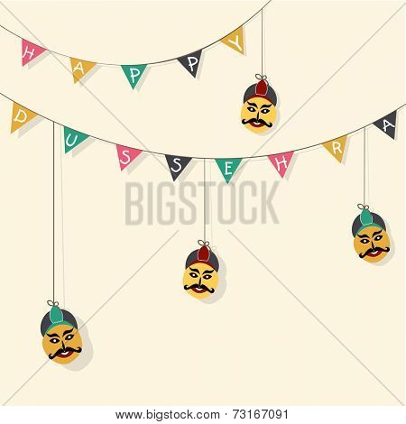Stylish text of Dussehra decorated by paper and funny faces hanging in rope on light skin colour background.